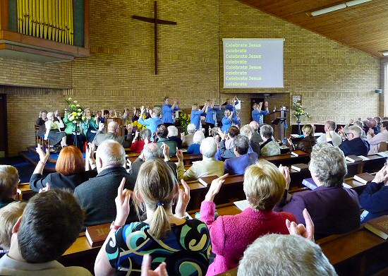The Albany Church Deaf Choir lead the congregation in singing by sign-language